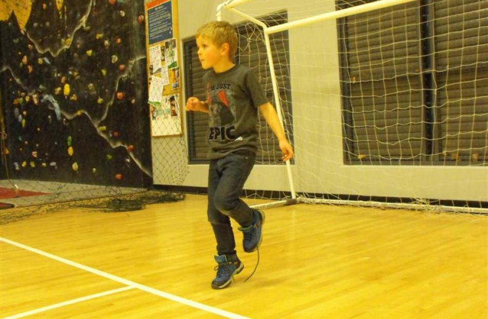 Alex Cooper, of Queenstown, guards his goal.