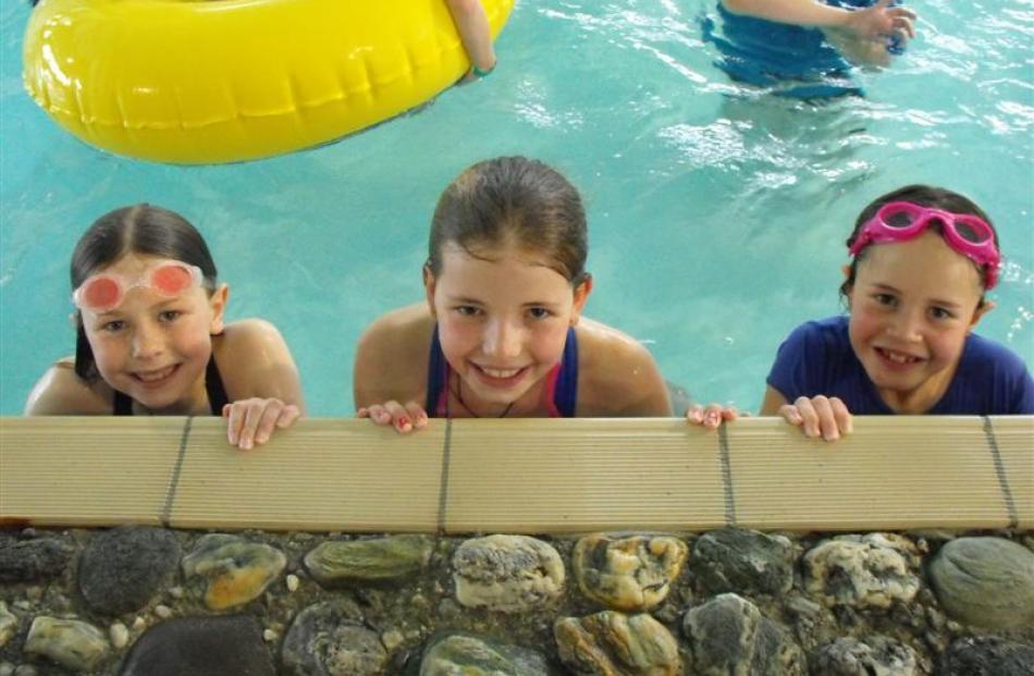 Queenstown girls (from left) Katie Hansen (9), Jessie Rowley (10) and Jasmin Savage (8)   enjoy...