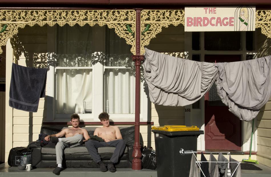 Catching some sunlight alongside their drying washing yesterday are Dunedin students Ashton...