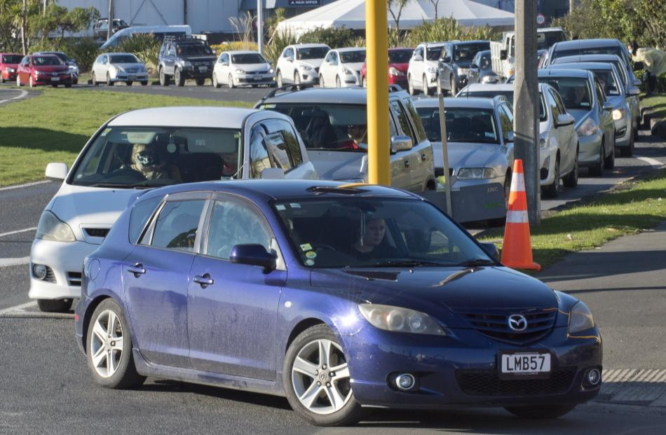 Cars back along Wharf St for the second day of the Te Kaika pop-up drive-through vaccination...
