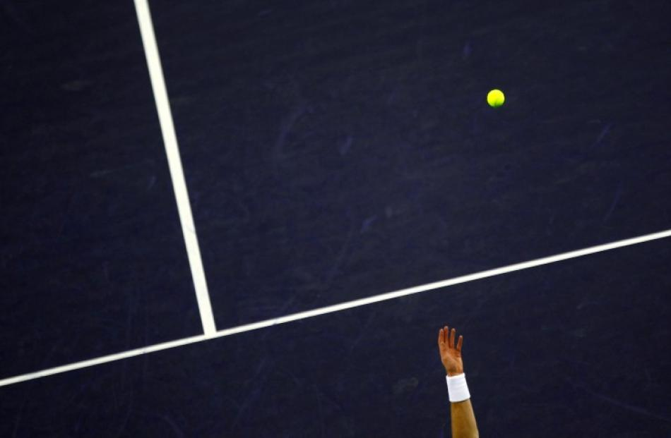 Andy Murray of Britain serves against Ukraine's Alexandr Dolgopolov during their singles match at...