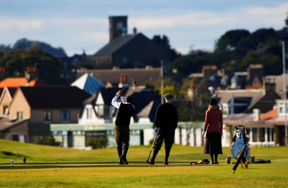 Competitors in the World Hickory Golf Championships tee off at Monifeith Links in Monifeith, east...