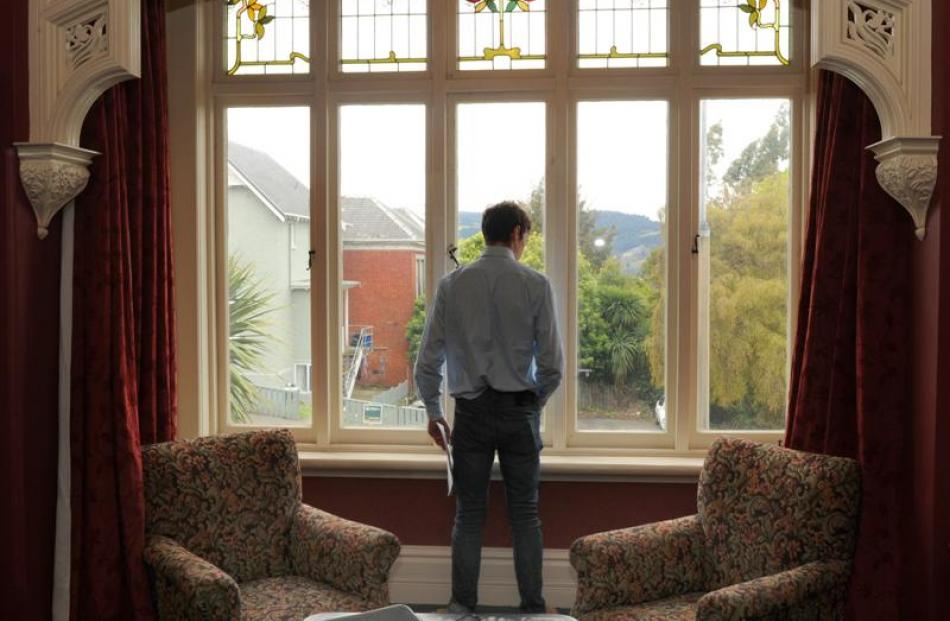 OUSA president and top-flat judge Logan Edgar admires the view from the flat.