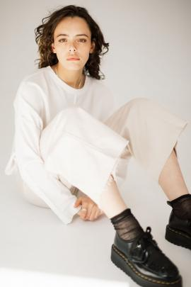 Monochromatic style is featured in Company of Strangers' Base Sweater in White. Ease is exuded in...