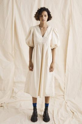 Nice Martin's Spencer Midi dress, refreshes with playful puff sleeve and a monochromatic neutral...