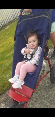 Invercargill toddler Fu'utoa Hufanga (21 months) gives a thumbs-up while out on a walk with her...