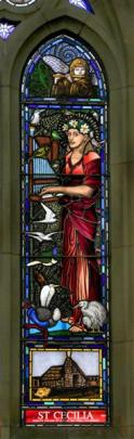 Dame Kiri Te Kanawa as St Cecilia in the newly installed stained glass window at St Paul's...