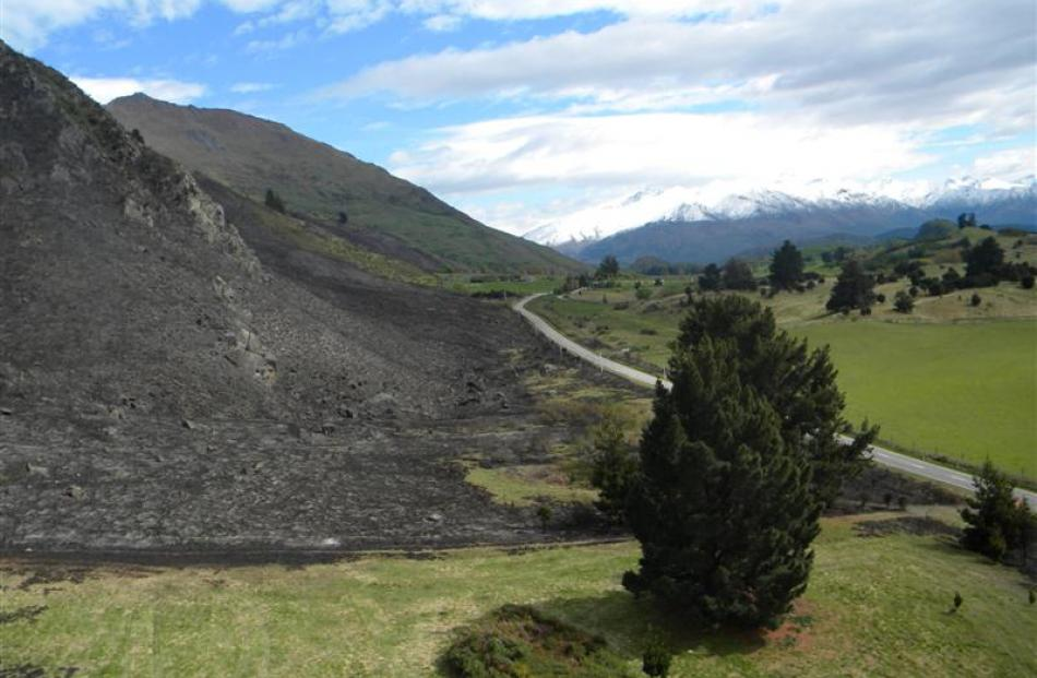 An out of control burn-off beneath Roys Peak, Wanaka, destroyed 350ha, leaving a blackened...