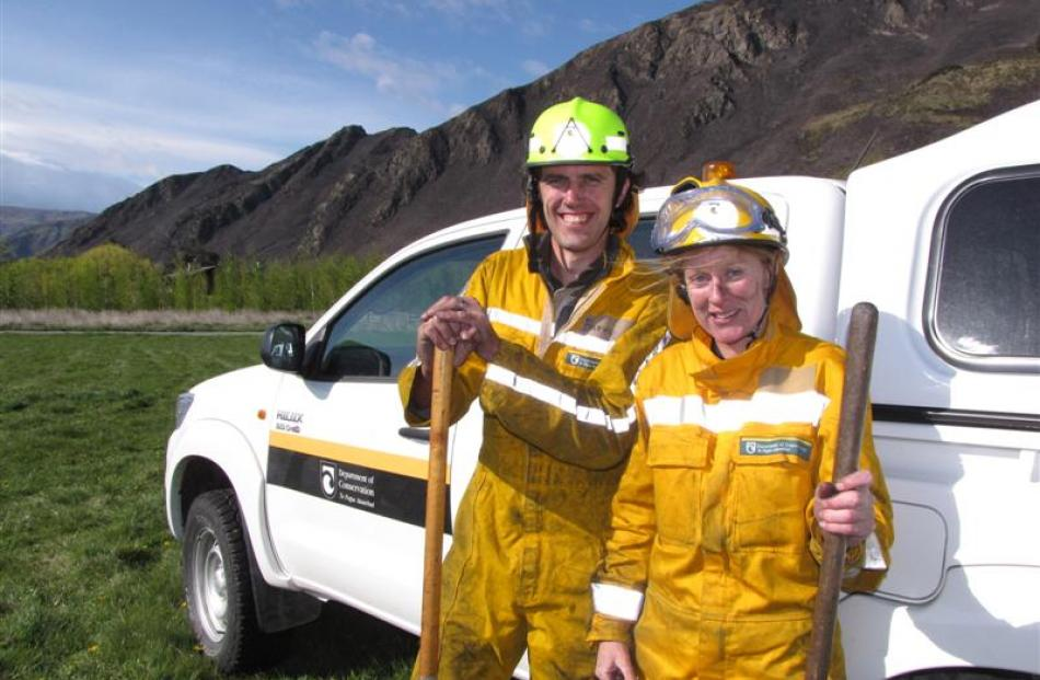 Department of Conservation rural firefighters Ed Astin and Sonya Sawyers manage a smile for the...