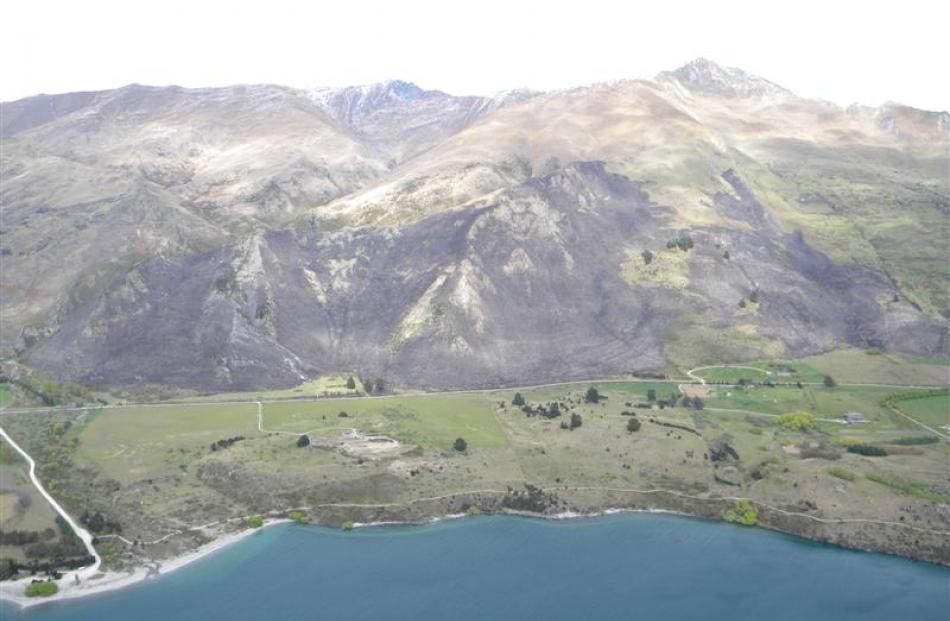 n aerial photo shows the 350ha of land damaged by an out of control burn-off below the Roys Peak...