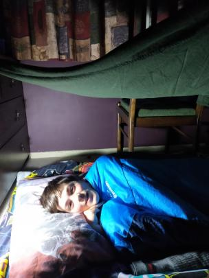 Xavier Bristow (11) creates a cosy camp in his bedroom during the Covid-19 Alert Level 4 lockdown...