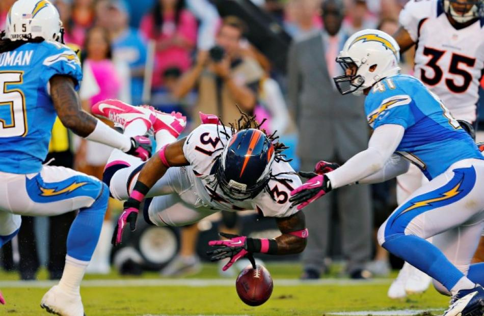 Denver Broncos cornerback Omar Bolden (31) fumbles the football on a kickoff as San Diego...