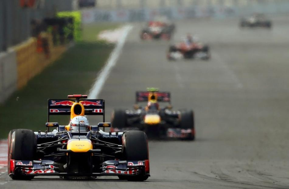 Eventual winner Sebastian Vettel of Germany leads the field in the South Korean F1 Grand Prix at...