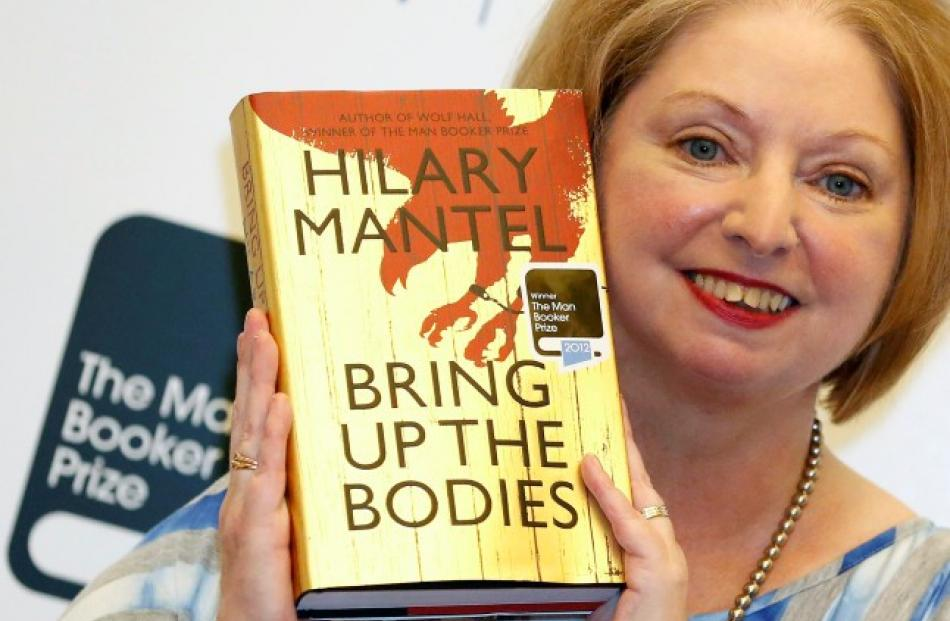 Author Hilary Mantel poses with her book 'Bring up the Bodies', after winning the 2012 Man Booker...