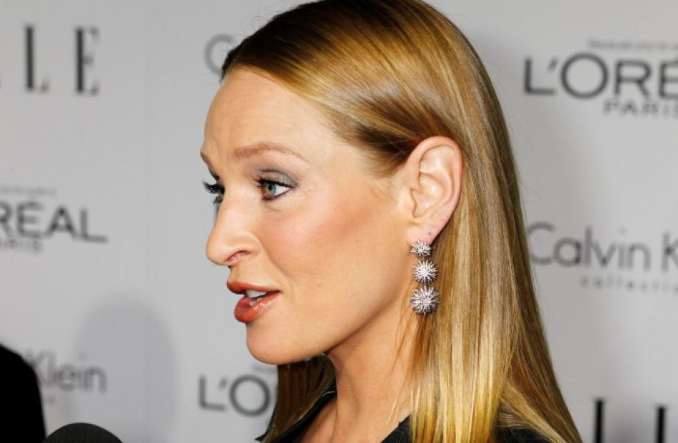 Honouree Uma Thurman is interviewed as she arrives at the 19th Annual ELLE Women in Hollywood...