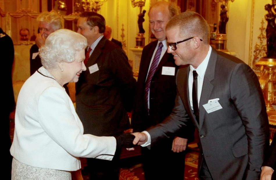Queen Elizabeth greets celebrity chef Heston Blumenthal during a reception for the organisers of...