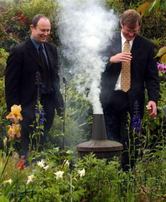 Graeme Martin (right) fires up his own incinerator one last time before urban backyard burning is...