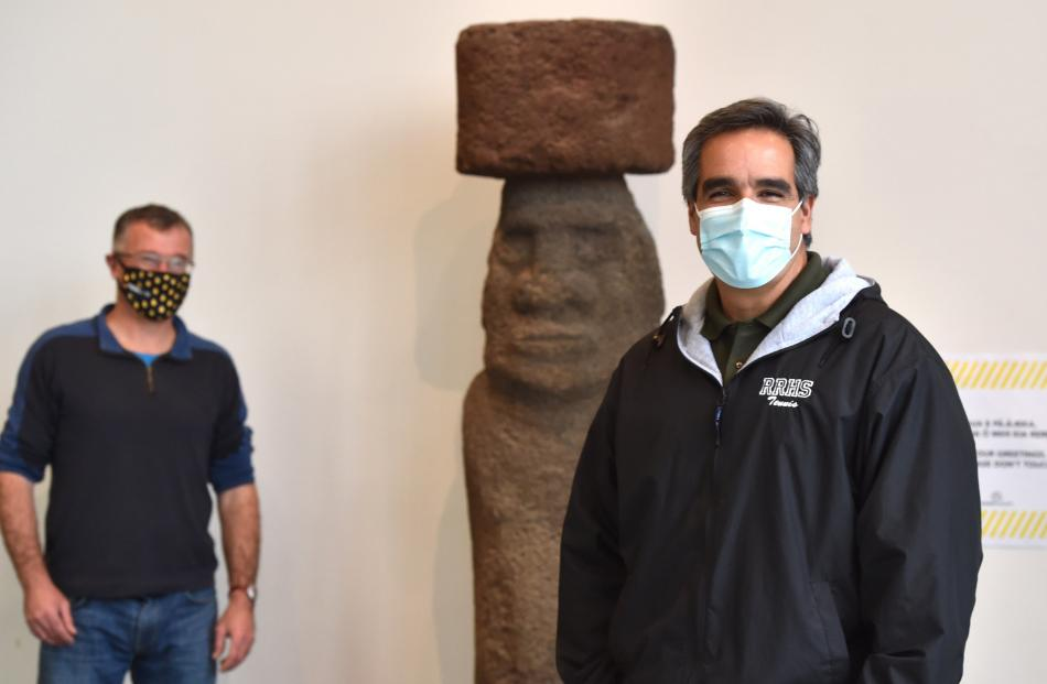 Inspecting an Easter Island Moai statue as part of preparations for reopening Otago Museum today...