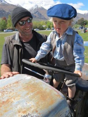 Glenorchy lad George Railton (2), with Greg Railton, approves of one of the vintage tractors on...