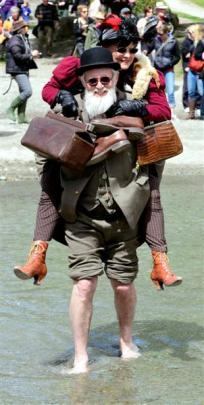 Colin Barnes of Hawkes Bay piggybacks his wife Judy across the Arrow River. Photos by Gerard O...