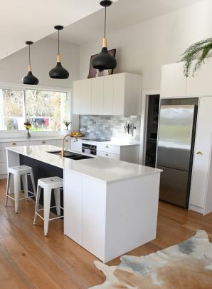 The new kitchen, modelled on a magazine cover, is a far cry from the original (next image). PHOTO...