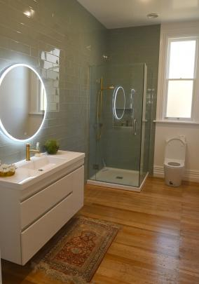 Green tiles feature in the bathrooms. PHOTO: LINDA ROBERTSON