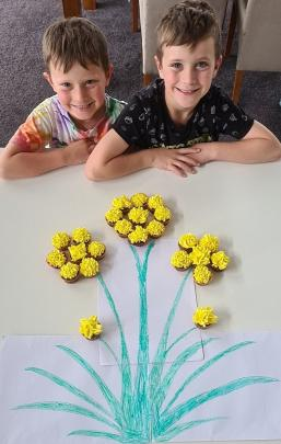 Brothers Lucas (left) and Carter Smith with their cupcake creation picture.
