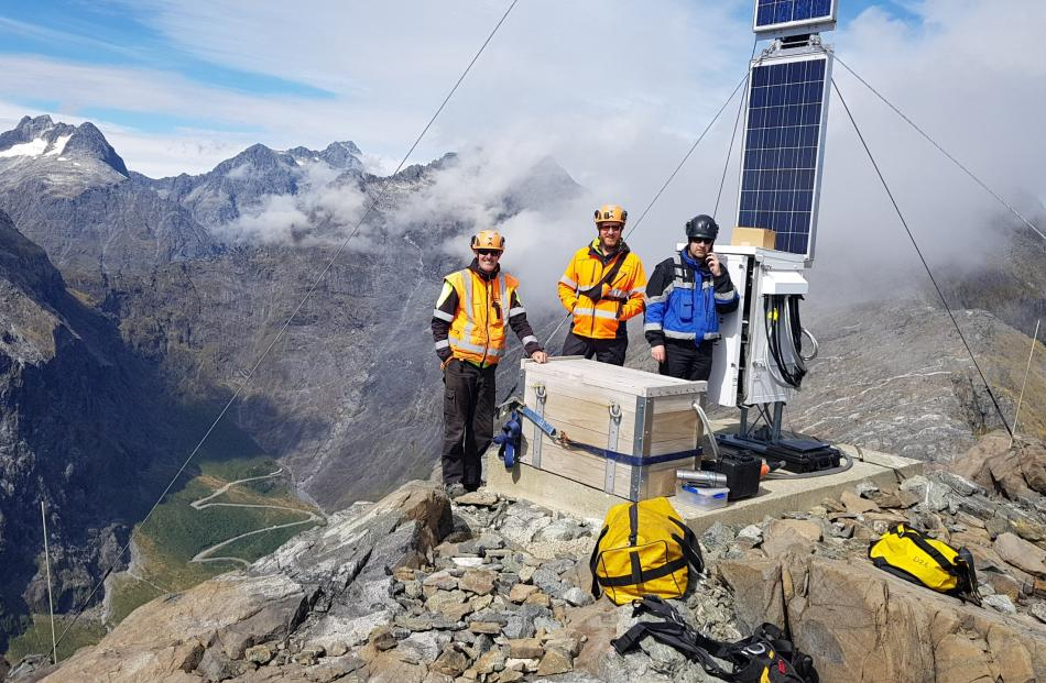 Milford Road Alliance crew check one of the seven alpine weather stations above the SH94 road....