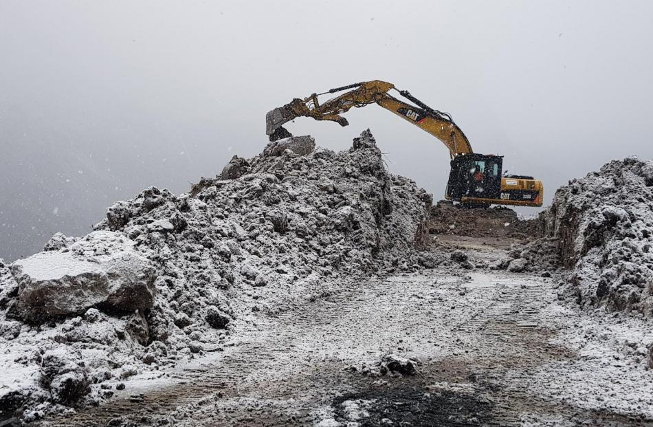 Working in treacherous conditions on rugged and steep terrain to open SH94 for road access.