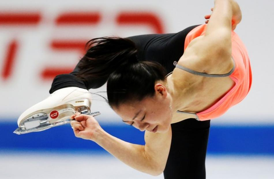 Akiko Suzuki of Japan skates during practice sessions before the Skate Canada International...