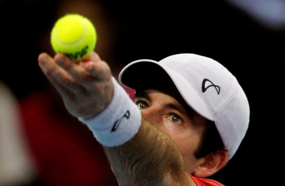 Brian Baker of the US prepares to serve against Argentina's Juan Martin del Potro at the Swiss...