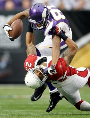 Minnesota Vikings receiver Jerome Simpson (81) is tackled by Arizona Cardinals Jamell Fleming (23...