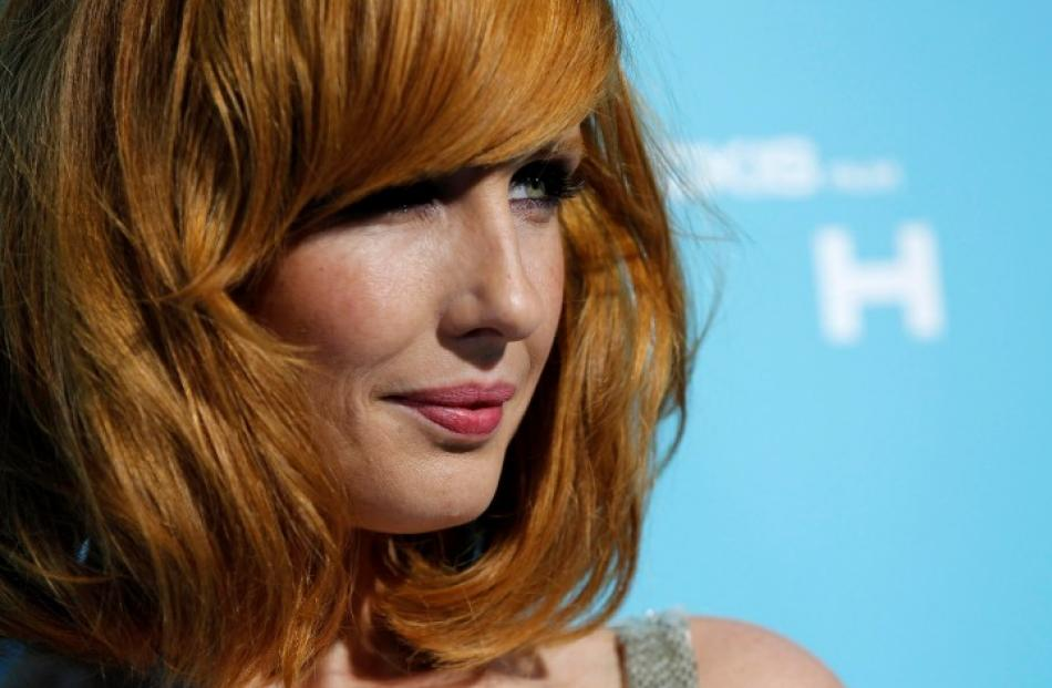 Cast member Kelly Reilly poses at the premiere of 'Flight' at the ArcLight Cinerama Dome in Los...
