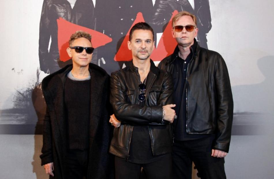 Depeche Mode members (L-R) Martin Gore, Dave Gahan and Andrew Fletcher pose during a photocall...
