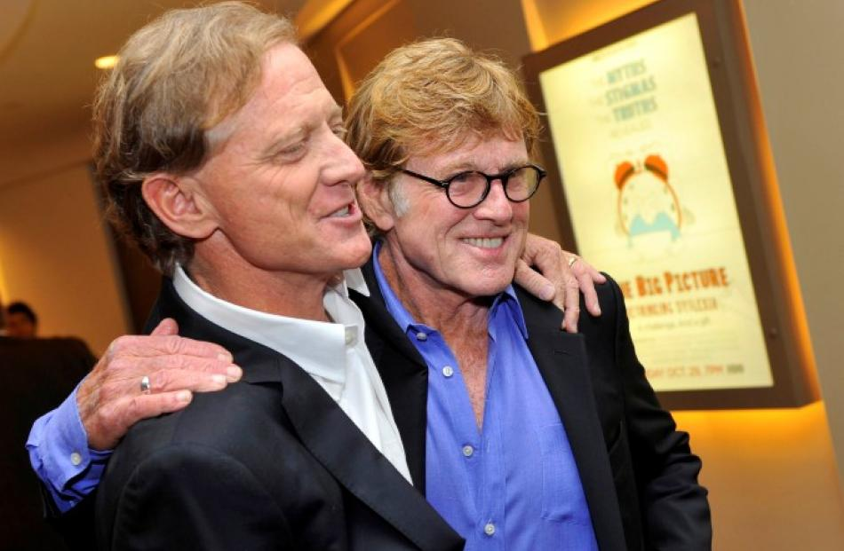 James Redford and his father, actor Robert Redford (R), arrive for the premiere screening of HBO...