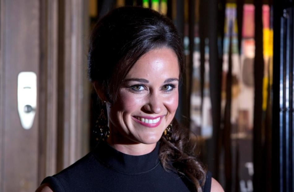 Pippa Middleton poses for photographers to promote her first book 'Celebrate', on the subject of...