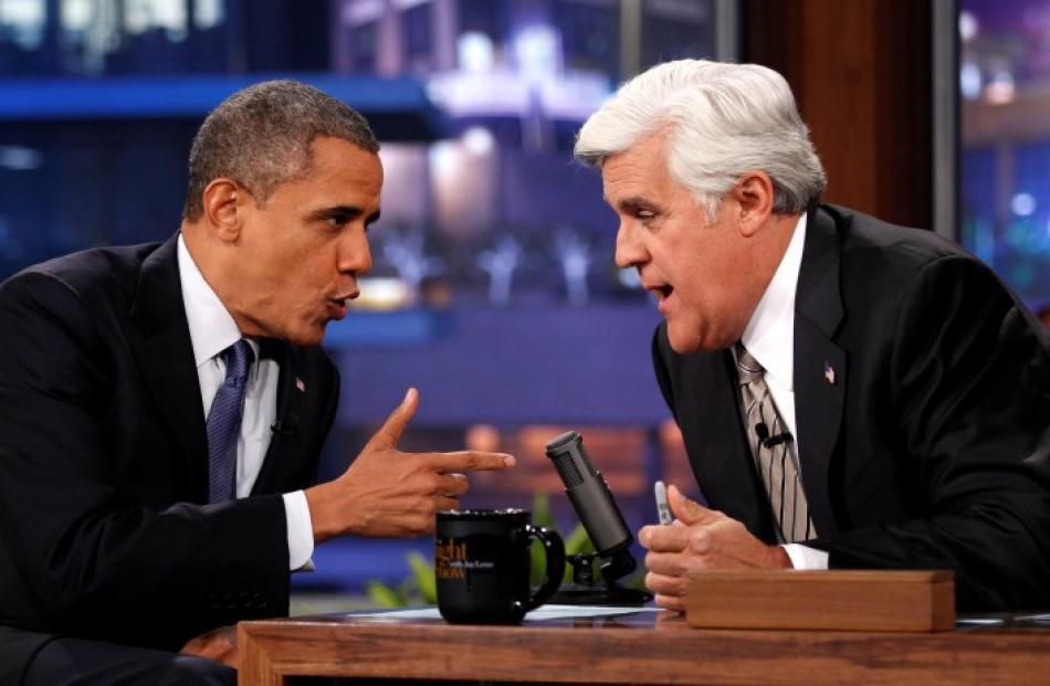 US President Barack Obama (L) makes an appearance on the Tonight Show with Jay Leno in Los...