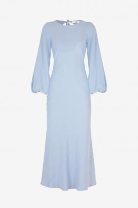 The Ruby, Kendall long-sleeve dress in powder blue captures the essence of softness with...