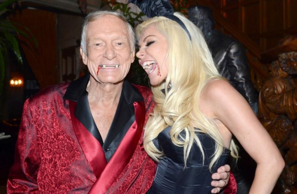 Playboy Magazine founder Hugh Hefner (L) and Crystal Harris pose at Hefner's annual Halloween...
