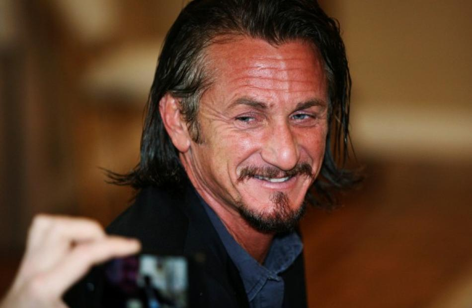 US actor Sean Penn attends a meeting with Bolivian President Evo Morales at the presidential...