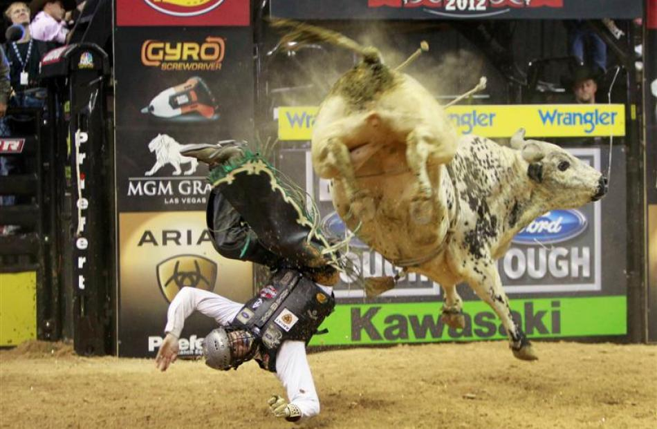 Jordan Hupp of the US gets thrown off a bull during the Built Ford Tough Series Professional Bull...