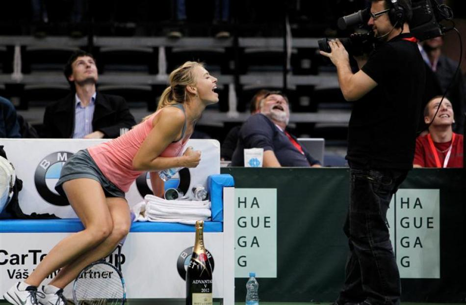 Russia's Maria Sharapova reacts to a television camera during an exhibition tennis match against...