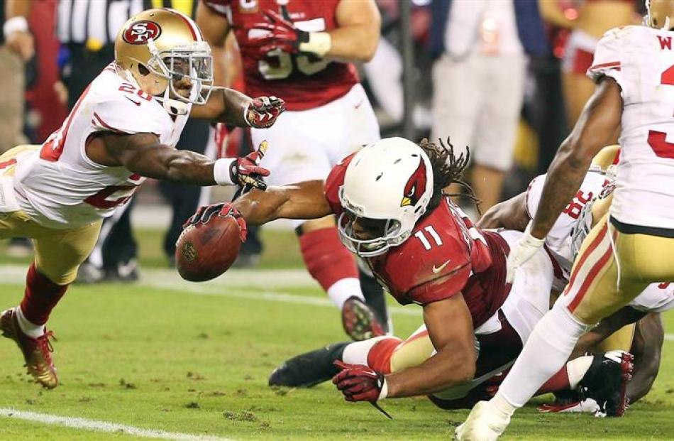 Arizona Cardinals Larry Fitzgerald is denied a last second touchdown by the San Francisco 49ers...