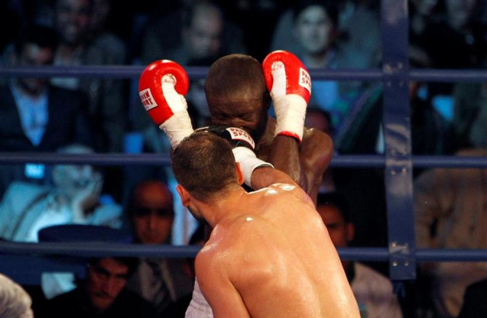 Afghan World Boxing Union champion Hamid Rahimi punches Said Mbelwa of Tanzania on his way to...