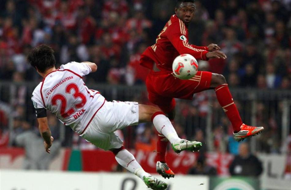 Bayern Munich's David Alaba fights for the ball with FC Kaiserslautern's Florian Dick. REUTERS...