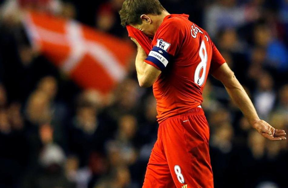 Liverpool's Steven Gerrard leaves the pitch after losing to Swansea in their English League Cup...