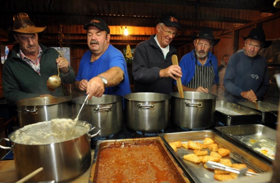 Members of the Alexandra Lion Club serve breakfast at Bannockburn's Cairnmuir Station. From left,...