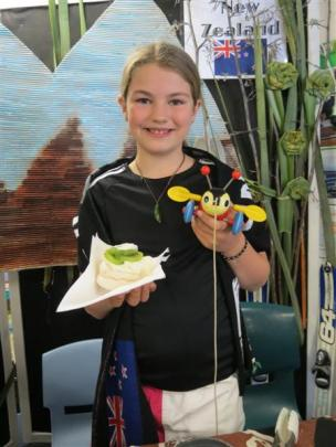 KingsView School pupil Mackenzie Shewan (10) shows she is a true blue Kiwi by serving pavlovas...
