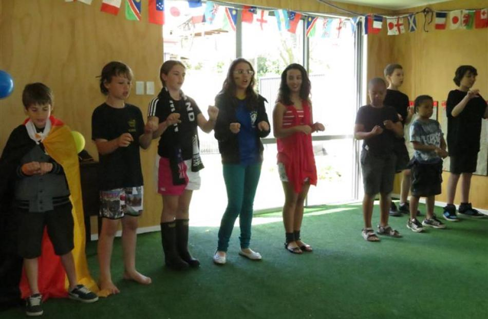 KingsView School pupils showcase their French language skills by singing a French song for...