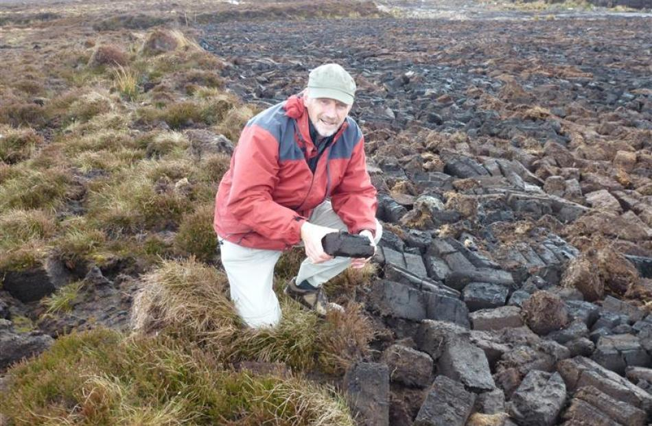Neville Peat meets Orkney peat at an extraction site at Hobbister Moor. The blocks of peat are...